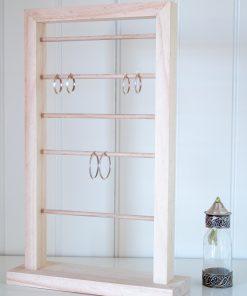 Expositor pendientes, tipo ventana con diferentes altura para pendientes grandes y pequeños tipo aro.